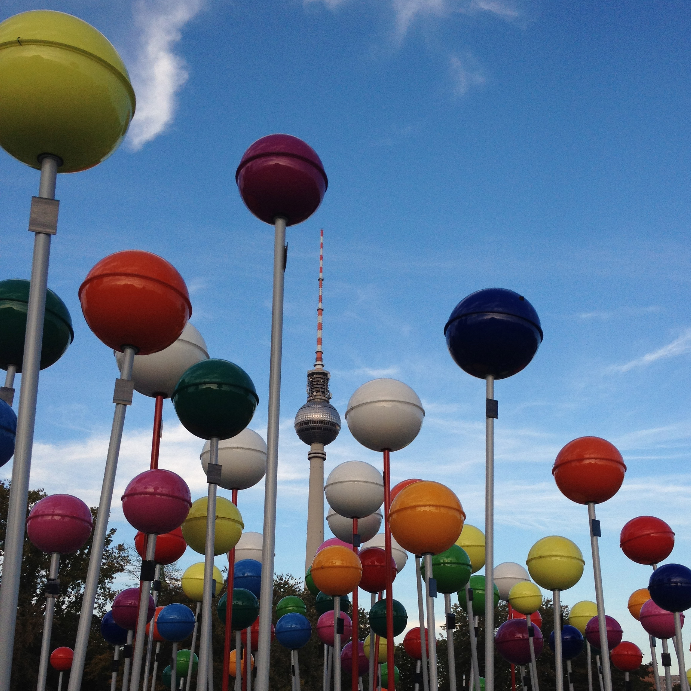 Hidden between the other colorful balls.